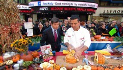 PHOTO: Buddy Valastro cuts the cake in half.