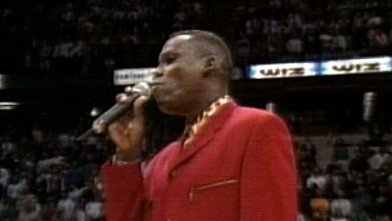 PHOTO: Carl Lewis sang the National Anthem at a Nets game in 1993.