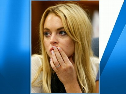 VIDEO: Lohan conveys an explicit message on her fingernail while in court.