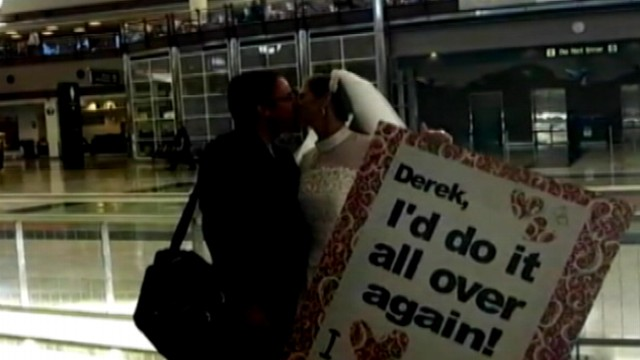 VIDEO: Lacy Matthews surprised her husband at a Denver airport wearing her gown on their anniversary.