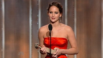 PHOTO: Jennifer Lawrence accepts her Golden Globe award, Jan 11, 2013.