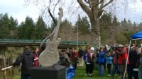 VIDEO: Guitar monument is erected in town where rock legend grew up.