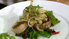 Michael Symon's pork tenderloin with greens and apples is shown here.