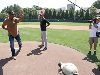 PHOTO: Rinku Singh, left, one of the subjects of Million Dollar Arm, is played by Life of Pis Suraj Sharmal, right. Shown here, Singh offers Sharmal some pitching tips.