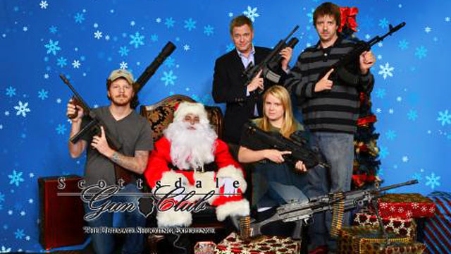 "PHOTO: ABCs David Wright (back left) and producer Erin Keohane (front) hold AK-47s while posing with Santa for the Scottsdale Gun Clubs ""Santa and Machine Guns"" event."