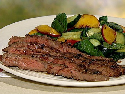 Mario Batali's skirt steak with peach cucumber salad is shown here.