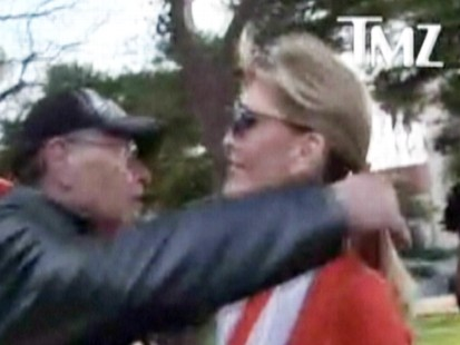 VIDEO: Larry King hugs his soon-to-be ex-wife at his sons baseball game.