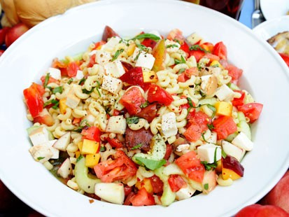 PHOTO: Ted Allens summer pasta salad with peaches and tomatoes is shown here.