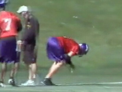 VIDEO: Brett Favre gets socked in the groin by a football during practice.