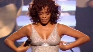 VIDEO: Whitney Houstons bra strap gives way during a concert performance.