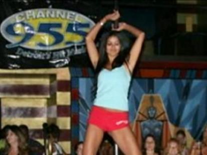 VIDEO: 007 photos show Rima Fakih participating in a Stripper 101 radio contest.