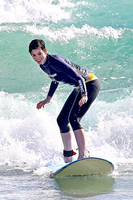Ann Hathaway Rides The Waves