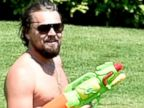 Leonardo DiCaprio Gets Aggressive with a Water Gun