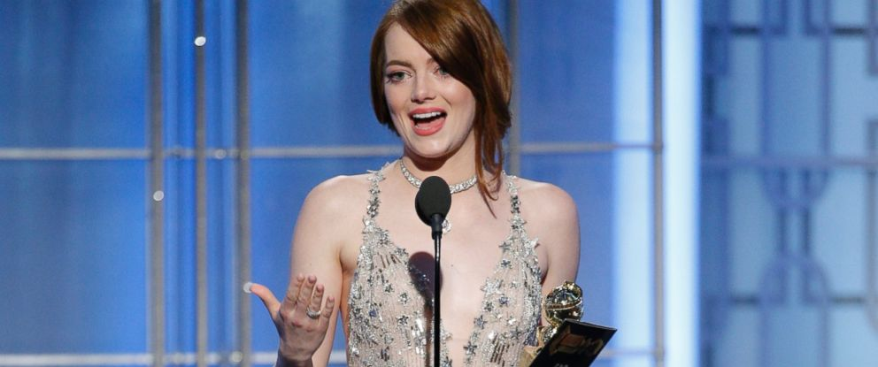 """PHOTO: Emma Stone accepts the award for best actress in a motion picture comedy or musical for her role in """"La La Land"""" at the 74th Annual Golden Globe Awards at the Beverly Hilton Hotel in Beverly Hills, Calif., on Jan. 8, 2017."""