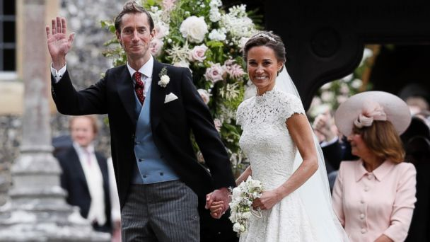 PHOTO: Pippa Middleton and James Matthews smile for the cameras after their wedding at St Mark's Church in Englefield, England, May 20, 2017.