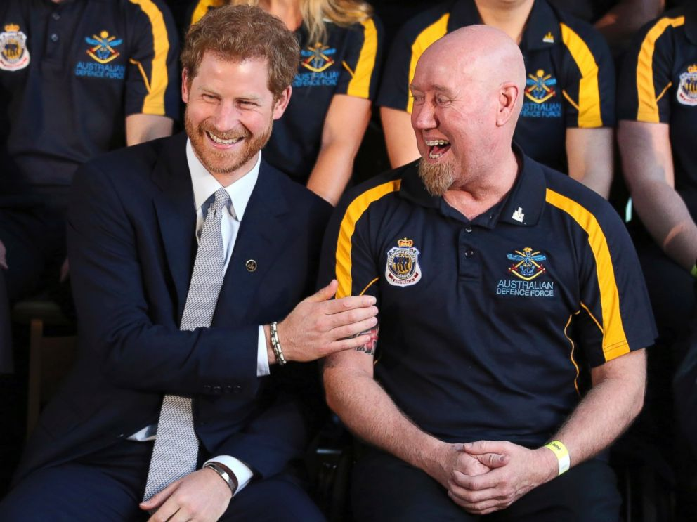 PHOTO: Britains Prince Harry laughs with Jeff Wright during a photo opportunity at a function at Admiralty House in Sydney, June 7, 2017. Prince Harry is in Sydney to launch the 2018 Invictus Games.