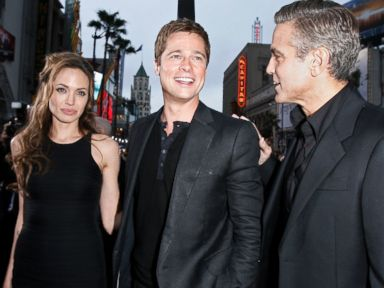 PHOTO: Angelina Jolie looks on as Brad Pitt and George Clooney pose at the premiere of Oceans Thirteen in Los Angeles, on June 5, 2007.