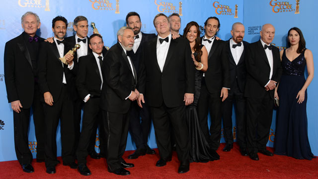 PHOTO: Actor and director Ben Affleck, sixth from left, and the cast and crew of &quot;Argo&quot; pose with the award for best motion picture - drama for &quot;Argo&quot; backstage at the 70th Annual Golden Globe Awards, Jan. 13, 2013, in Beverly Hills, Calif.