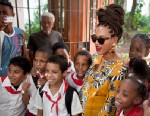 PHOTO: Beyonce poses for photos with school children as she tours Old Havana, Cuba, April 4, 2013. Beyonce is in Havana with her husband, rapper Jay-Z, on their fifth wedding anniversary.