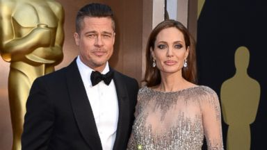 PHOTO: Brad Pitt and Angelina Jolie arrive at the Oscars, March 2, 2014, at the Dolby Theatre in Los Angeles.