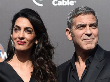 PHOTO: Amal Clooney and George Clooney arrive at the world premiere of Tomorrowland at AMC Downtown Disney, May 9, 2015, in Anaheim, Calif.