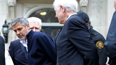PHOTO: Actor George Clooney, center, Rep. Jim Moran, D-Va, back, and Clooney's father, Nick Clooney, right, are arrested during a protest at the Sudanese Embassy in Washington, March 16, 2012.