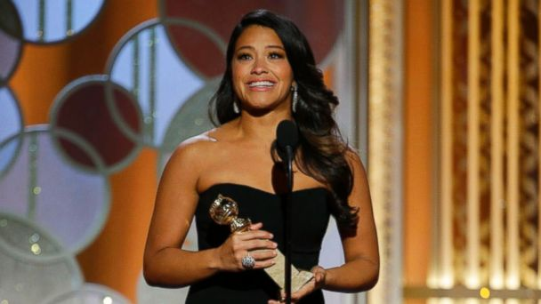 """PHOTO: Gina Rodriguez accepts the award for best actress in a TV series, comedy or musical for her role in """"Jane the Virgin"""" at the 72nd Annual Golden Globe Awards, Jan. 11, 2015 at the Beverly Hilton Hotel in Beverly Hills, Calif."""