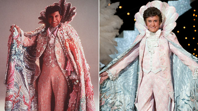 "PHOTO: Liberace, wearing his shiny rings and dress, is seen in this 1987 photo while actor Michael Douglas, right, is seen portraying the performer in the 2013 film, ""Behind the Candelabra""."