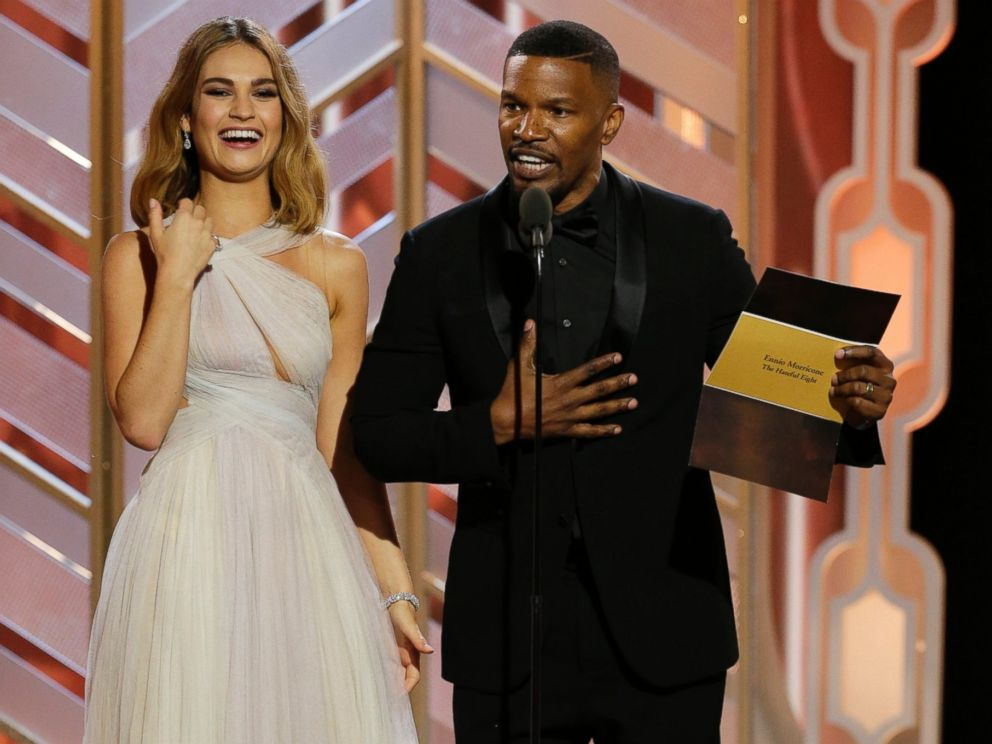 PHOTO: Lily James and Jamie Foxx present an award at the 73rd Annual Golden Globe Awards at the Beverly Hilton Hotel in Beverly Hills, Calif., on Jan. 10, 2016.