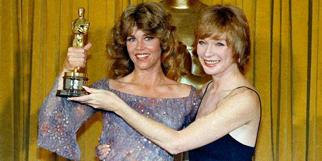 "PHOTO: Jane Fonda, the Oscar Winner for Best Actress in ""Coming Home,"" with presenter Shirley Maclaine in this April 9, 1979 file photo at the 51st Academy Awards in Los Angeles."