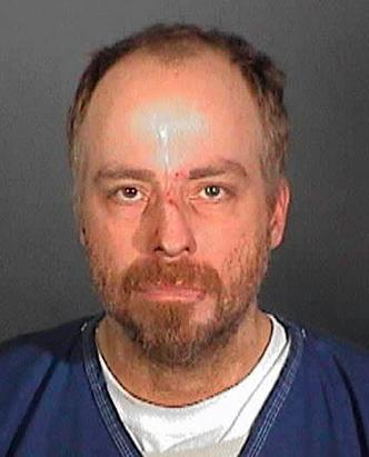 Cops: Rip Torn Drunk, Armed in Bank