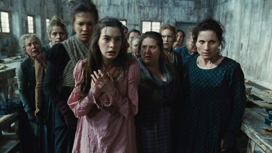"PHOTO: This undated publicity photo provided by Universal Pictures shows Anne Hathaway, left, as Fantine, being thrown out of the factory in a scene from director, Tom Hooper's new film, ""Les Misérables,"" the motion-picture adaptation of the beloved globa"