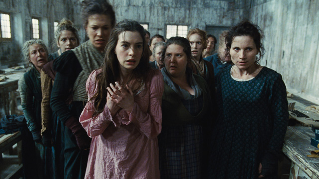 "PHOTO: This undated publicity photo provided by Universal Pictures shows Anne Hathaway, left, as Fantine, being thrown out of the factory in a scene from director, Tom Hoopers new film, ""Les Misérables,"" the motion-picture adaptation of the beloved globa"