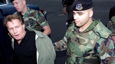 PHOTO: Actor Martin Sheen is arrested by Vandenberg Air Force Security Police at Vandenberg Air Force Base, Calif., Oct. 7, 2000.