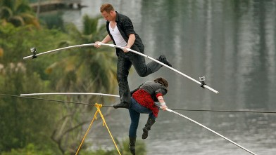 PHOTO: High-wire acrobats Delilah Wallenda, right, lowers her head as her son Nik Wallenda, left, crosses over her during their high-wire act where the two simultaneously walked across a 300-foot-long wire suspended 100 feet in the air between two towers