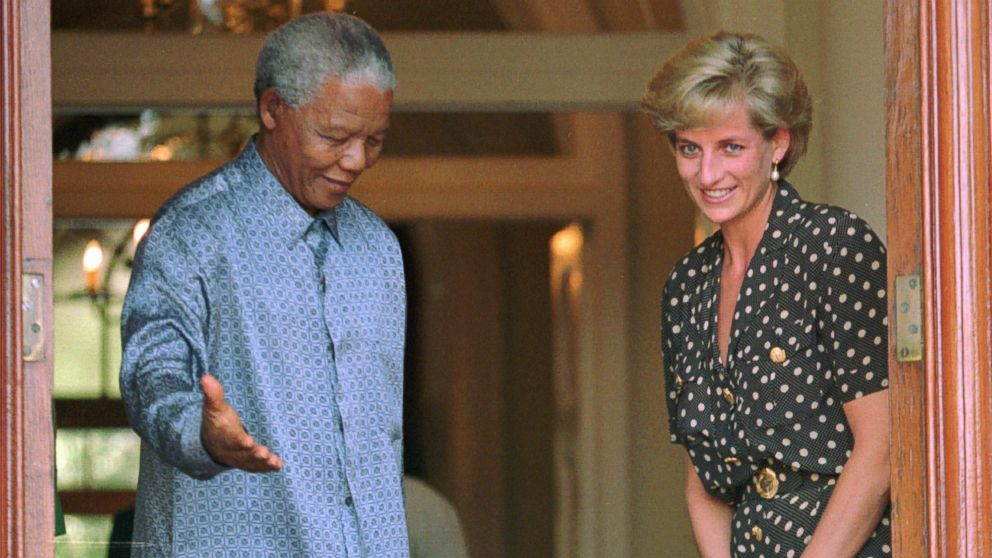 PHOTO: In this March 17, 1997 file photo, South African President Nelson Mandela, left, shows the way to Britains Princess Diana in Cape Town, South Africa, where they discussed the threat of AIDS in the country.