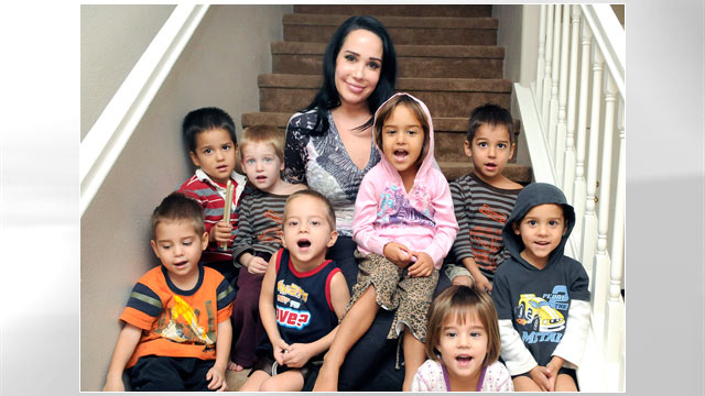 PHOTO: Nadya Suleman, also known as &quot;Octomom,&quot; rear center, poses with some of her children at their new home in Palmdale, Calif., Oct. 23, 2012.