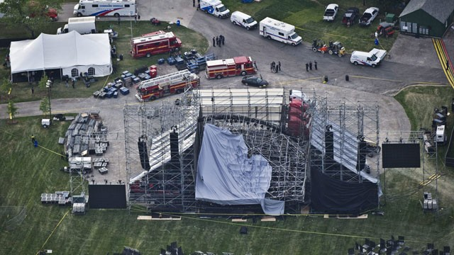 PHOTO:&nbsp;This aerial view shows a collapsed concert stage being set up for a concert by band Radiohead at Downsview Park in Toronto, Saturday, June 16, 2012.