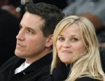 PHOTO: In this Friday, March 8, 2013 file photo, actress Reese Witherspoon and her husband, Jim Toth, watch the Toronto Raptors take on the Los Angeles Lakers in an NBA basketball game in Los Angeles.