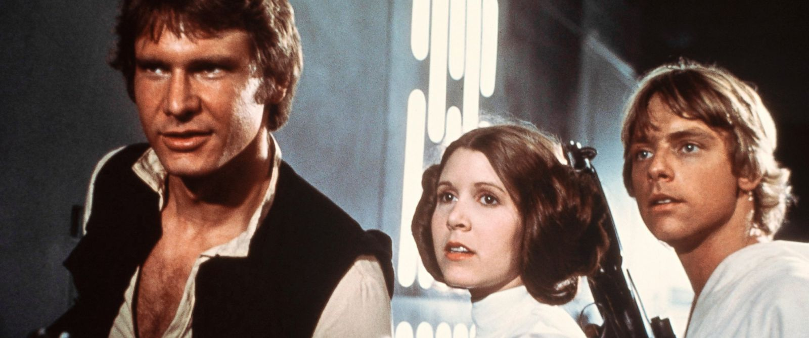 "PHOTO: Harrison Ford, as Han Solo, Carrie Fisher, as Princess Leia, and Mark Hamill, as Luke Skywalker in a scene from the 1977 movie, ""Star Wars IV: A New Hope."""