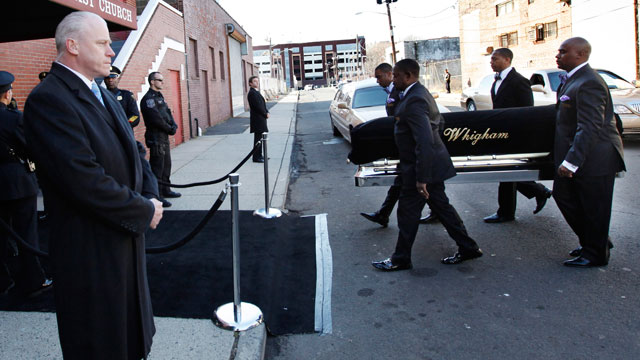 PHOTO: A coffin holding the remains of singer Whitney Houston is carried into the New Hope Baptist Church before funeral services for the singer in Newark, N.J. on Feb. 18, 2012.