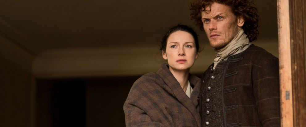 "PHOTO: Caitriona Balfe and Sam Heughan in a scene from ""Outlander,"" 2014."