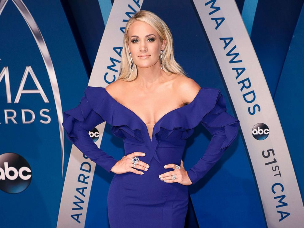 Carrie Underwood hospitalized after falling outside home