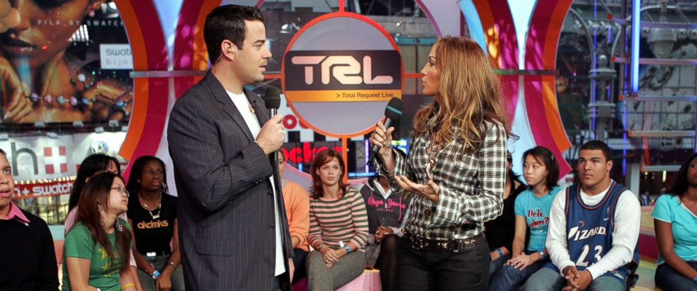 PHOTO: Jennifer Lopez appears on stage with MTV VJ Carson Daly during MTVs Total Request Live at the MTV Times Square Studios October 14, 2004 in New York.