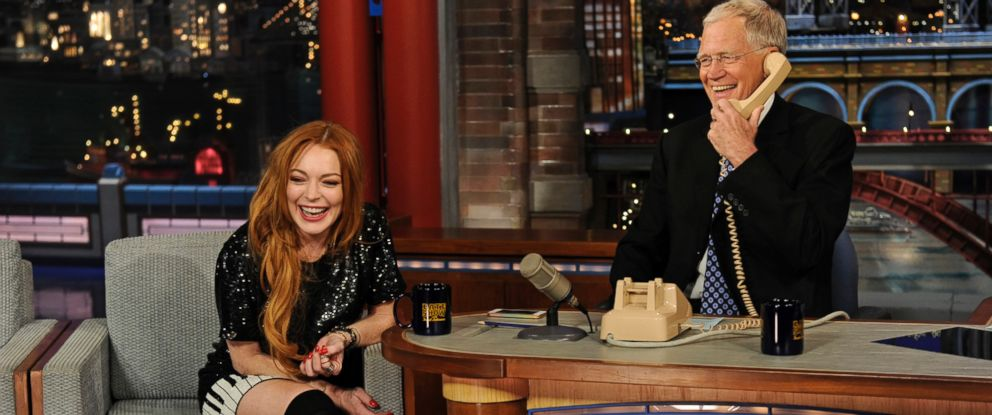 PHOTO: David Letterman and Lindsay Lohan give a call to their mutual friend Oprah Winfrey when Lohan visits The Late Show with David Letterman, April 9, 2014.