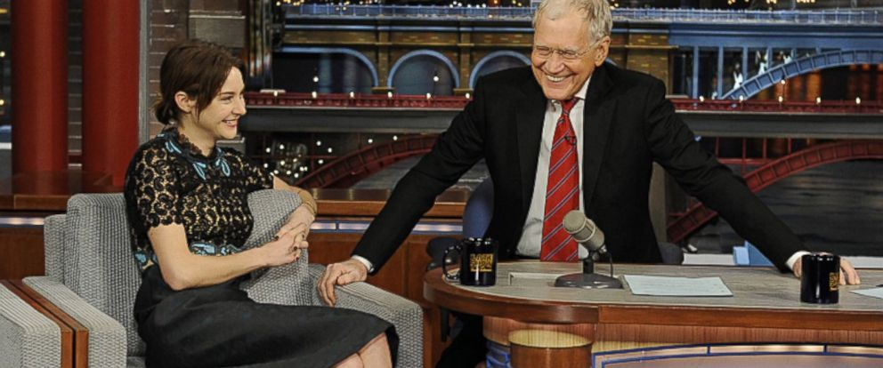 PHOTO: Actress Shailene Woodley shares a laugh with David Letterman when she visits the Late Show with David Letterman, March 16, 2015.