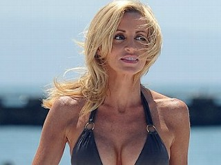 Photos: Camille Grammer Shows Off Body