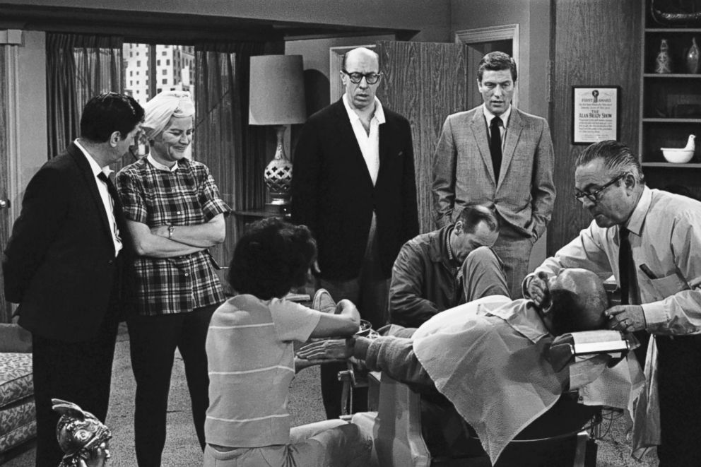 """PHOTO: From left, Morey Amsterdam, Rose Marie, and Richard Deacon, and Dick Van Dyke, right, gather around Carl Reiner, in barber chair, during a rehearsal of an episode for the """"The Dick Van Dyke Show,"""" on April 11, 1963."""
