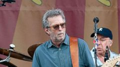 'PHOTO: Eric Clapton performs during the 2014 New Orleans Jazz & Heritage Festival1_b@b_1Fair Grounds Race Course, April 27, 2014, in New Orleans.' from the web at 'http://a.abcnews.com/images/Entertainment/eric-clapton2-gty-mem-180111_16x9t_240.jpg'
