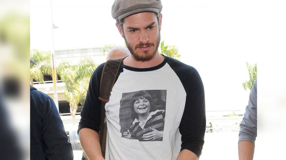 What 39 s this new trend of celebrities wearing shirts with for Celebrity t shirts wholesale